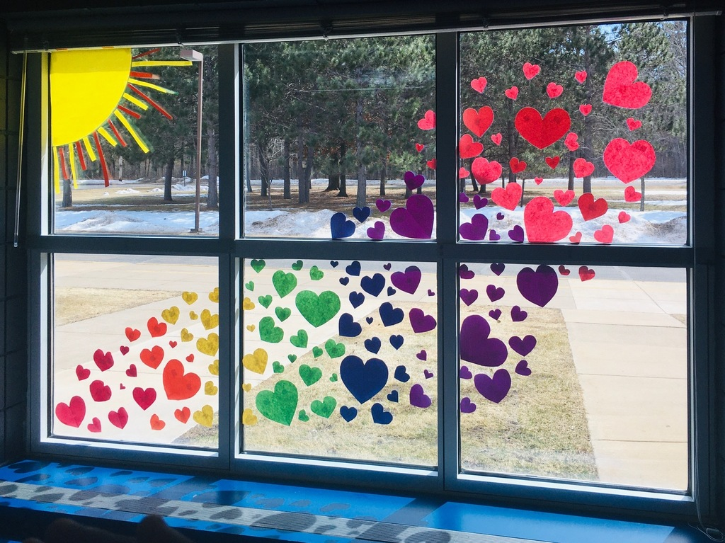 window full of colorful hearts