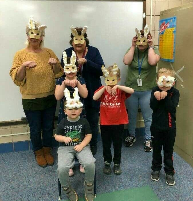 staff and students in bunny masks