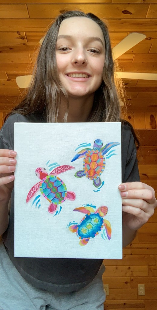 female student with painting of turtels