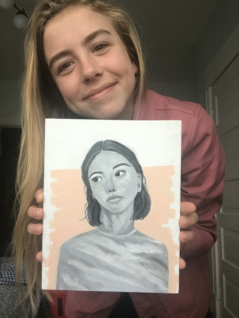 female student with a portrait painting