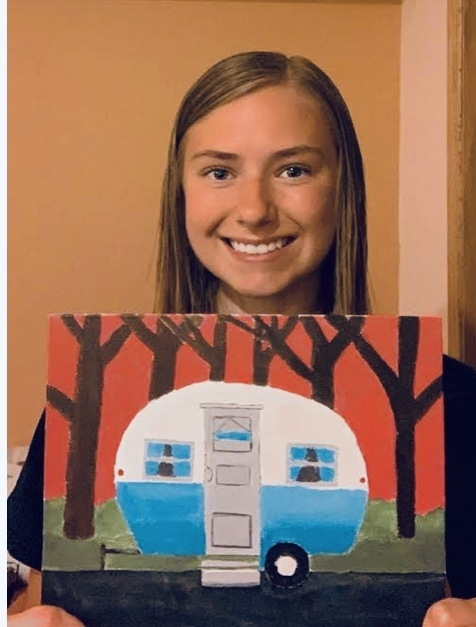 female student with a camper painting