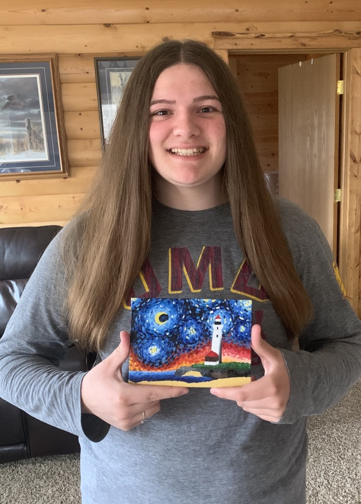 female student with a painting of starry night