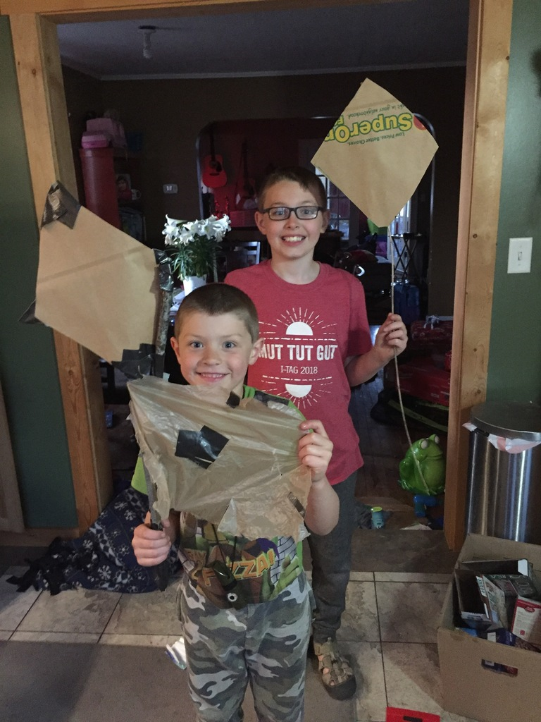two male students holding a homemade kite